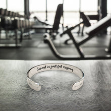 "Load image into Gallery viewer, ""Sweat Is Just Fat Crying"" Engraved Silver Tone Cuff BeStrong"