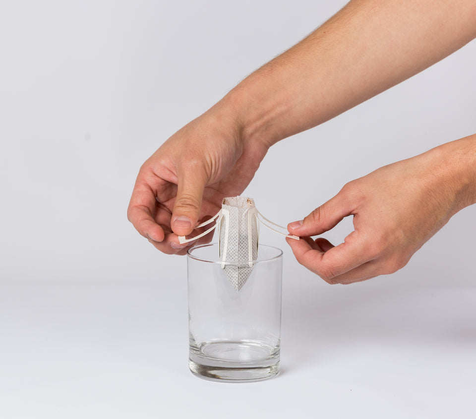 Open the hanging ears on the side of the portable pour over coffee filter and hook them on the edge of your cup or mug.
