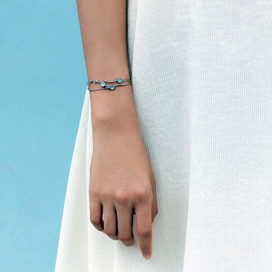 Music of the Sea Bracelet  · Sterling Silver with Dolphin Gemstone