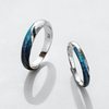 »Two Rivers« Couple Rings · Sterling Silver & Emerald Plating