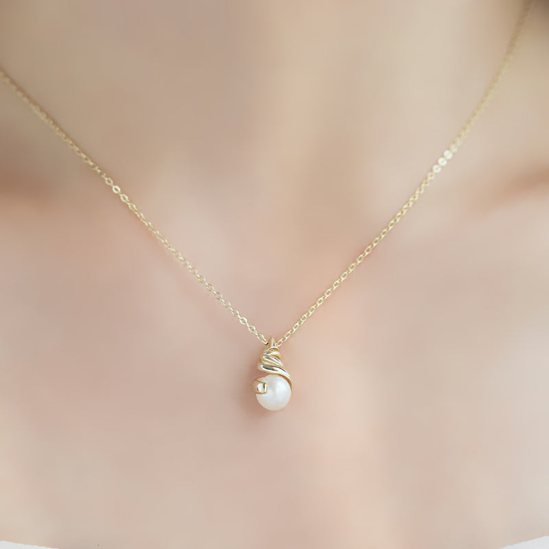 Conch Shell Necklace · Sterling Silver with Gold Plating and Natural Pearl