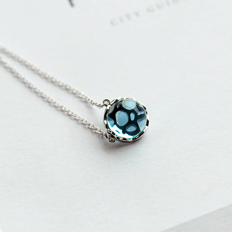 Ocean Ripple Necklace · Sterling Silver with Hollow Blue Crystal