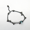 Blue Thorn Rose Bracelet  · Black Plated Sterling Silver with Blue Crystal