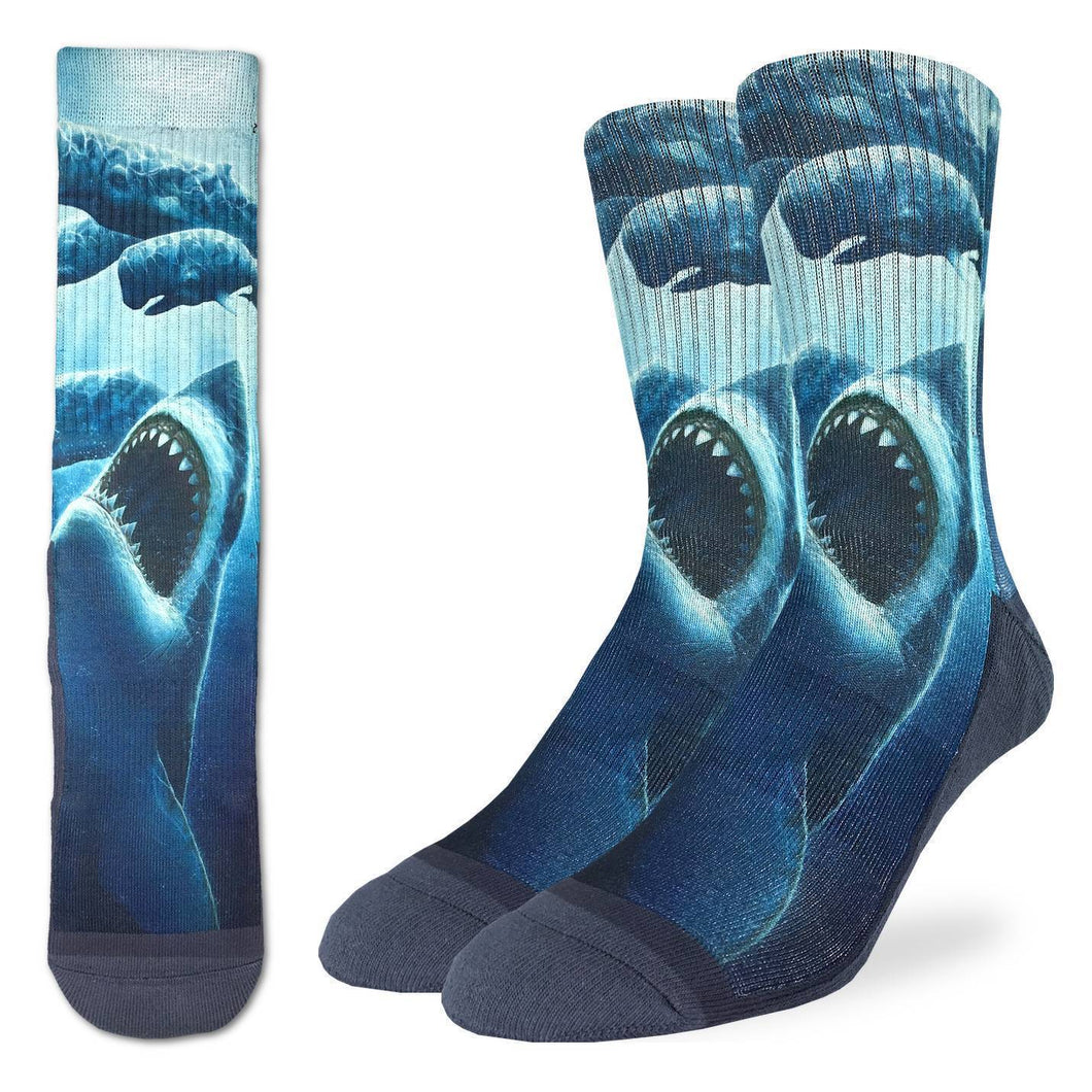 Crew length blue socks with image under the ocean of shark swimming up to attack whales
