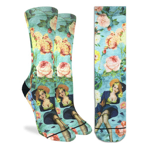 Crew length light blue socks with roses and a pinup girl
