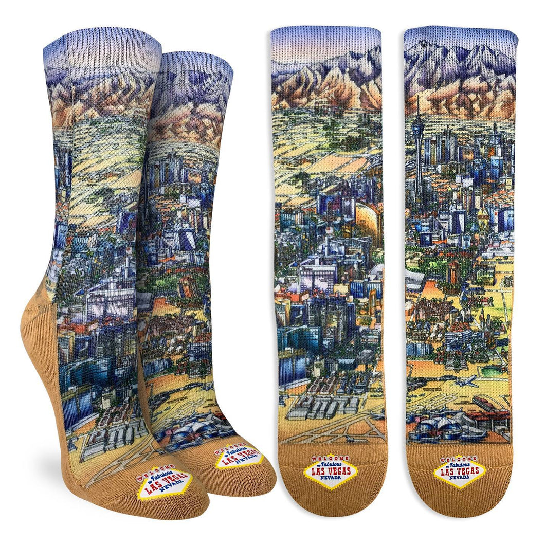 Crew length socks a natural sandy color with the image of the Las Vegas strip on the front of the socks