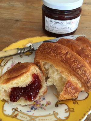 Strawberry jam with croissant