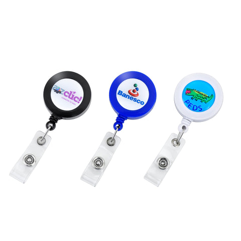 "Picture of Round, solid body color badge reels with 35"" cord, with slip on back clip, prices includes 0.8"" epoxy domed logo"