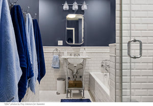 A bathroom remodel gets blue tile and a coat of blue paint