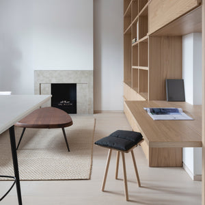 From a mini-fridge to a folding desk and a concealed make-up mirror, this compact London apartment designed by local firm MWAI features a variety of space-saving solutions.
