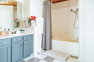Earlier this year, we challenged ourselves to give our master bathroom an entirely new look with just paint a few minimal materials