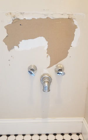 How to cut out wall to install brace for pedestal sink?