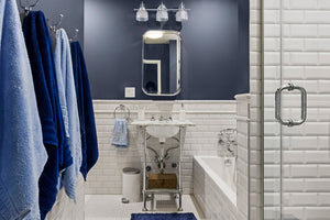 When Rachel and Michael's art deco bathroom remodel came to life in 2019, we were wowed by the various shades of blue
