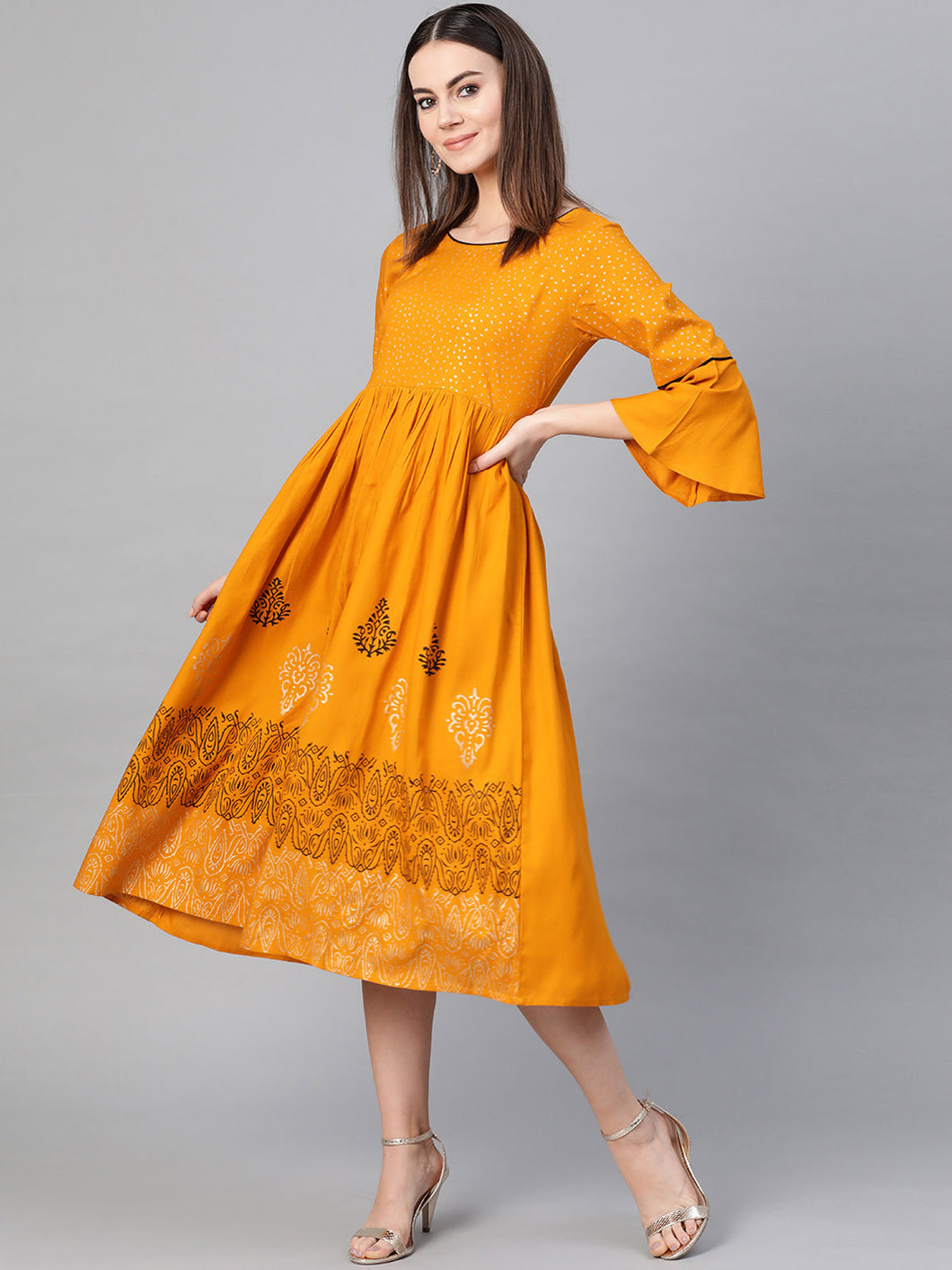 Yellow printed  A-line dress, has a round neck