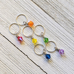 six crystal stitch markers in one of each rainbow color red orange yellow green blue purple