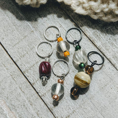 medium sized stitch markers in glass and ceramic beads for knitting and crochet projects