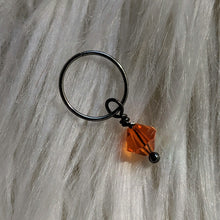 Load image into Gallery viewer, orange faceted crystal glass bead dangle on dark gunmetal black ring
