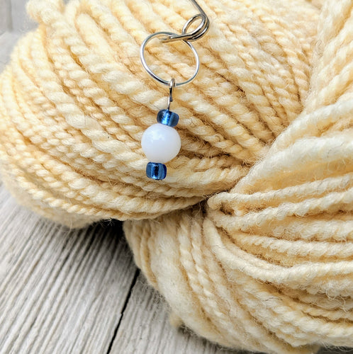 stitch marker for knitting or crochet with white and blue ceramic and glass beads on silver
