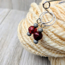 Load image into Gallery viewer, two stitch markers for knitting or crochet with apple red and matte grey glass beads on silver