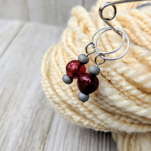 two stitch markers for knitting or crochet with apple red and matte grey glass beads on silver