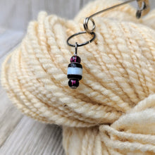 Load image into Gallery viewer, stitch marker for knitting or crochet with black and white striped ceramic and clear dark purple glass beads on gunmetal black