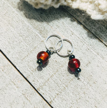 Load image into Gallery viewer, two stitch markers for knitting or crochet with apple red and metallic green glass beads on silver