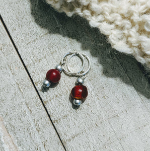 two stitch markers for knitting or crochet with apple red and silver glass beads on silver