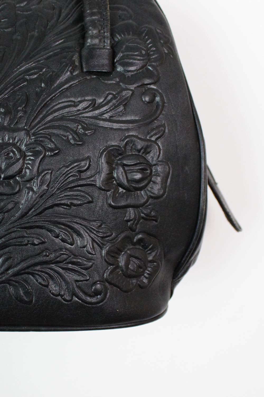 60s tooled leather bag detail
