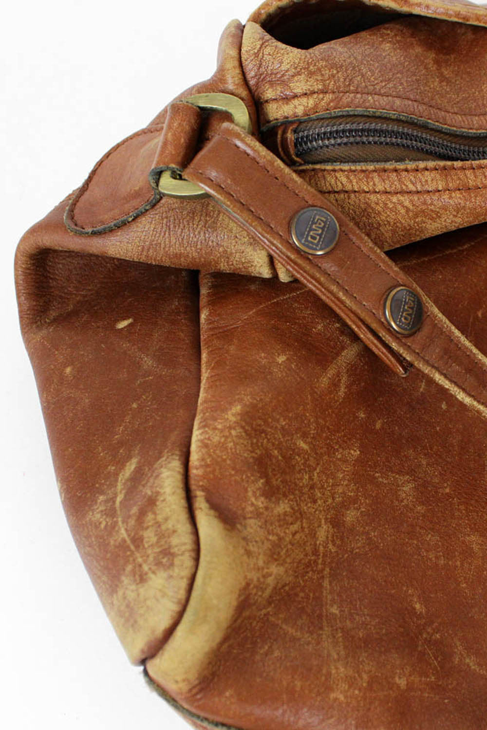 distressed duffel bag