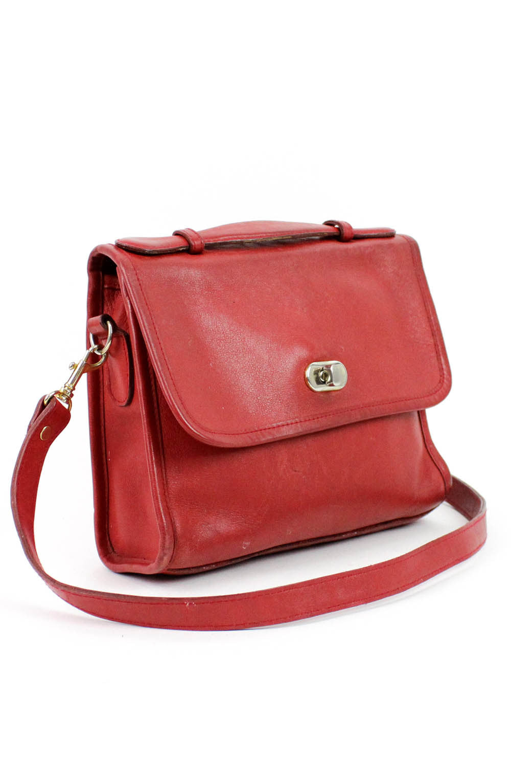 red coach style bags