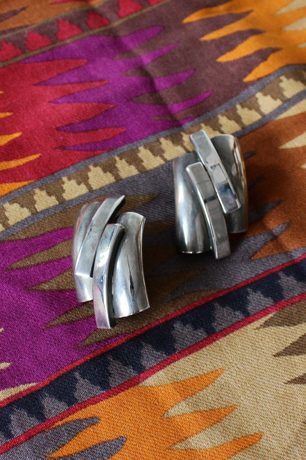 Abstract Silvertone Clip-ons
