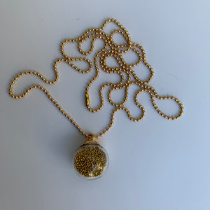 Hanger With Tiny Golden Balls Inside