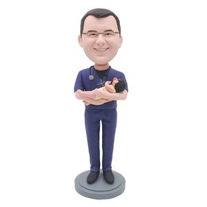 Personalized Bobblehead Obstetrician And Gynecologist Holding A Baby - Abobblehead.com
