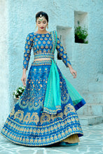 Load image into Gallery viewer, Irreproachable Harbour Blue Silk Embroidered Work With Immaculate Lahenga Choli