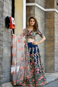 Gratifying Radiant Navy Blue Silky Silk Flower Embroidered Work With Tip Top Lehenga Choli