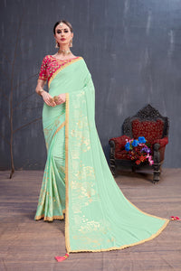 Remarkable Mint Green Georgette Rubber Foil & Fancy Lace Work With Amazing Saree