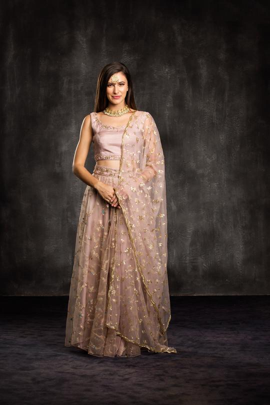 Ornamented Jasmin Dusty Rose Soft Mono Net Hand Embroidery Work With Radiant Lehenga Choli