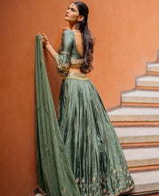 Load image into Gallery viewer, Improved Basil Pine Green Pure Raw Silk Heavy Hand Embroidery Work With Notable Lehenga Choli