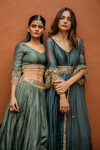 Improved Basil Pine Green Pure Raw Silk Heavy Hand Embroidery Work With Notable Lehenga Choli