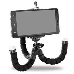 Black flexible tripod shown with legs bent and demonstrator phone attached.