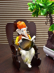 Creative Lord Ganesha Reading Book Resting on Rocking Chair