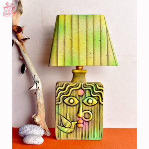 Lady in Green Shade with Bird Table Lamp