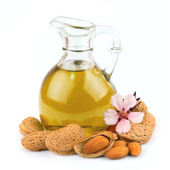 almond oil with almonds placed around it