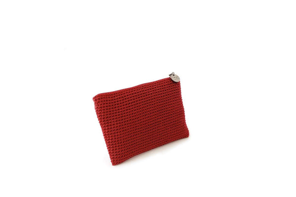 Mulberry Red full crochet purse with silver zipper and circle shaped silver charm with Dowa branding.