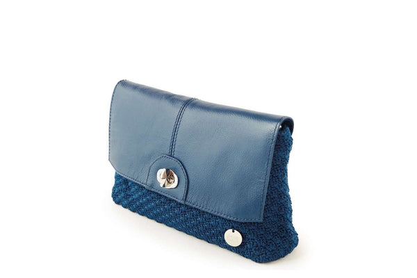 Twilight Blue handmade, crochet ladies clutch with black leather flap-over closure, silver metal front clasp, and small dowa silver metal logo.