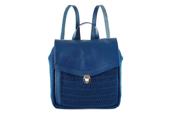 Twilight Blue crochet backpack with genuine leather flap-over closure. Adjustable leather ribbon straps, with a similar looking carry handle loop. Concealed external zipped compartment. Dowa metal silver logo attached to the side crocheted panel of bag.