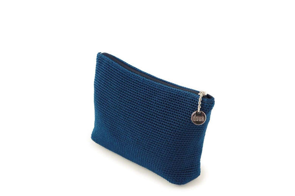 Twilight Blue full crochet cosmetics organiser with silver zipper and circle shaped silver charm with Dowa branding.