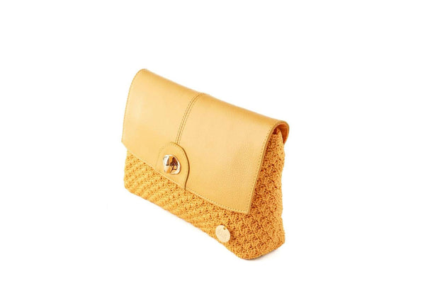 Yellow/Nugget Gold handmade, crochet ladies clutch with black leather flap-over closure, silver metal front clasp, and small dowa silver metal logo.