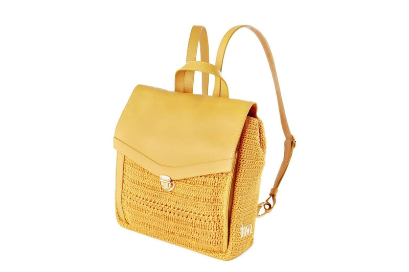 Yellow/Nugget Gold crochet backpack with genuine leather flap-over closure. Adjustable leather ribbon straps, with a similar looking carry handle loop. Concealed external zipped compartment. Dowa metal silver logo attached to the side crocheted panel of bag.