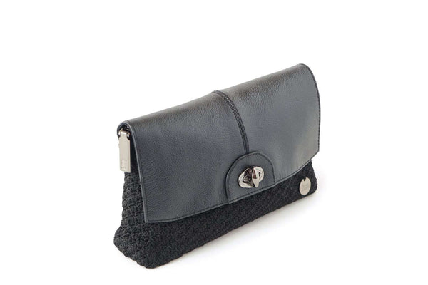 Black handmade, crochet ladies clutch with black leather flap-over closure, silver metal front clasp, and small dowa silver metal logo.